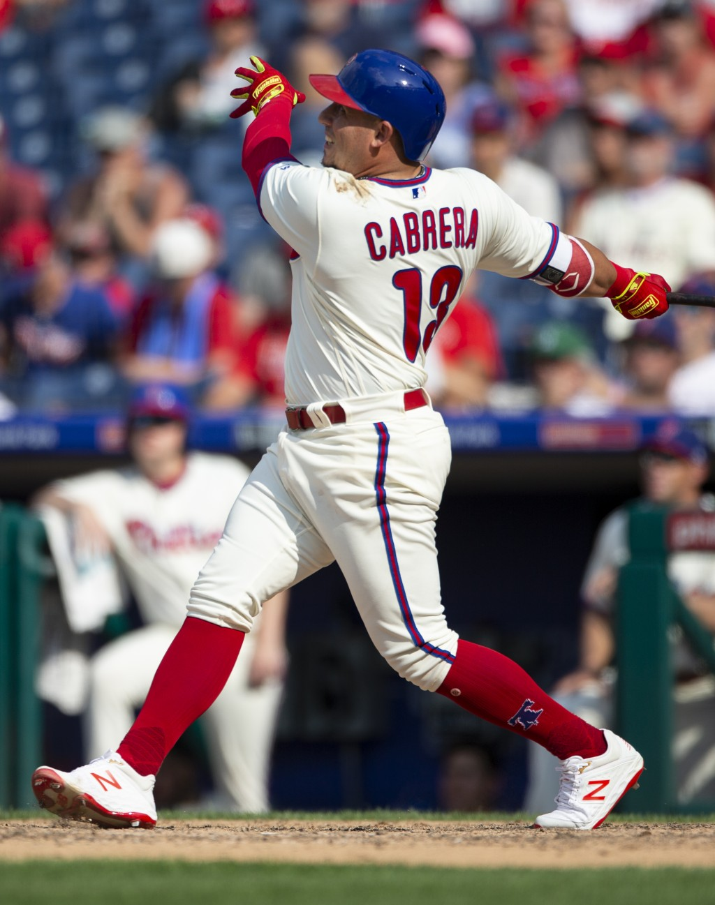 Philadelphia Phillies' Asdrubal Cabrera (13) follows through on a two-run home run in the eighth inning of a baseball game against the Miami Marlins, ...