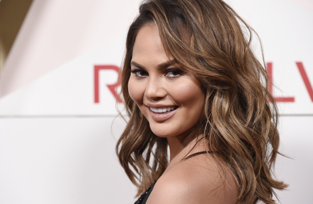 FILE - In this Nov. 2, 2017 file photo, model Chrissy Teigen poses at the 2017 Revolve Awards at the Dream Hollywood hotel in Los Angeles. Chrissy Tei...