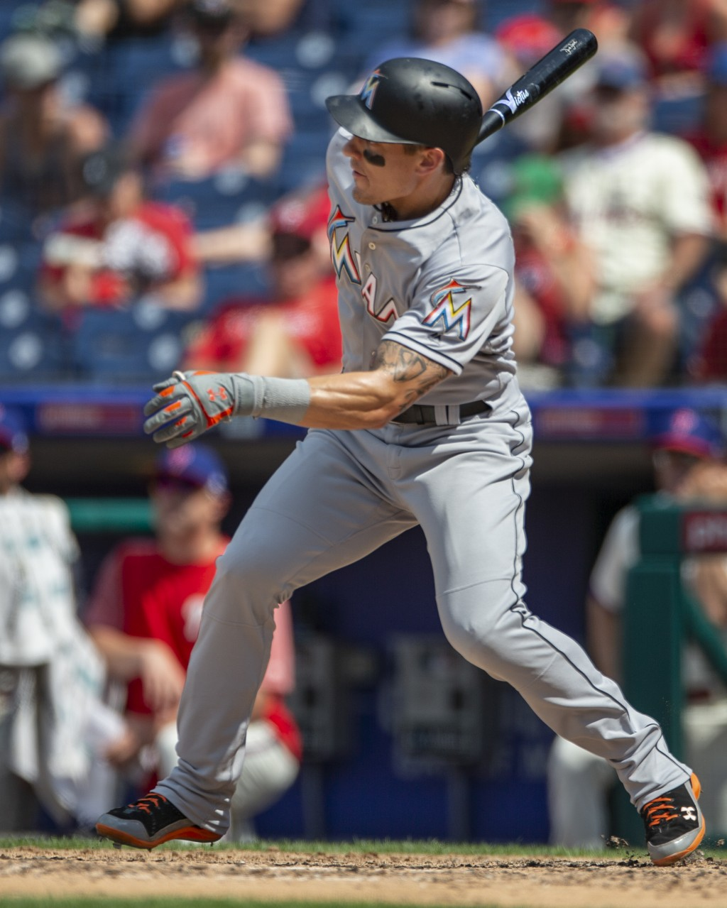 Miami Marlins' Derek Dietrich follows through on a single during the fifth inning of a baseball game against the Philadelphia Phillies, Sunday, Aug. 5...