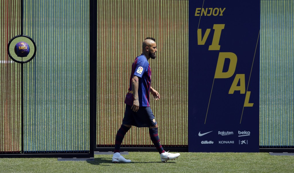 Barcelona's new signing Chilean soccer player Arturo Vidal during his official presentation at the Camp Nou stadium in Barcelona Spain Monday Aug