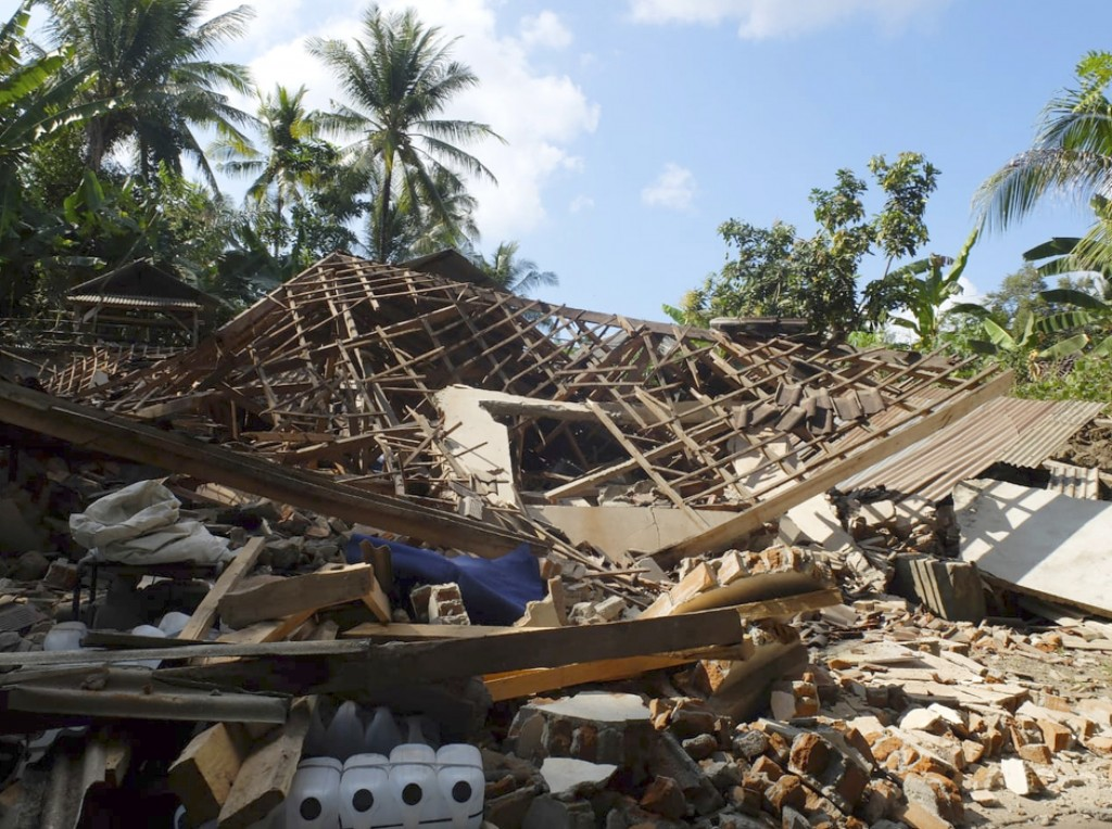 Houses damaged by an earthquake are seen in North Lombok, Indonesia, Monday, Aug. 6, 2018. The powerful earthquake struck the Indonesian tourist islan