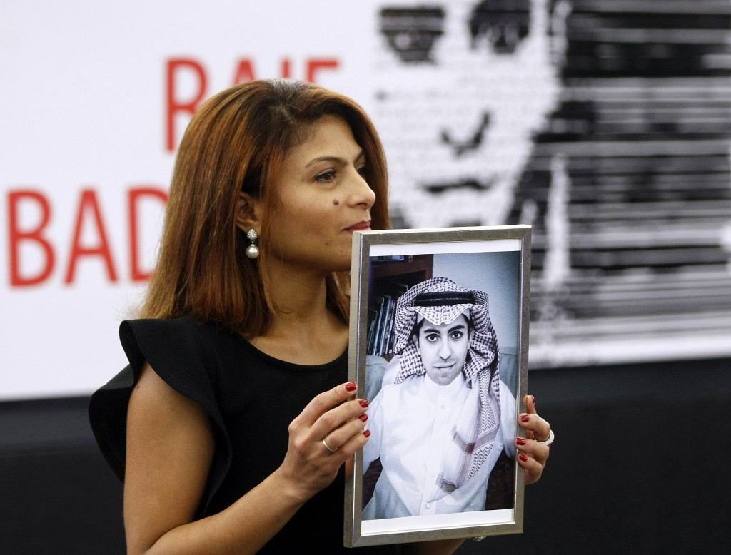 FILE - In this Dec, 16, 2015 file photo, Ensaf Haidar, wife of the jailed Saudi Arabian blogger Raif Badawi, shows a portrait of her husband as he is
