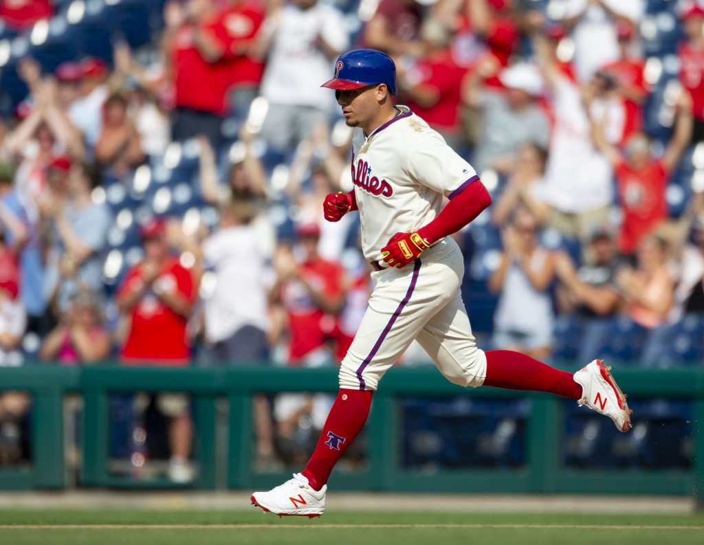 Philadelphia Phillies' Asdrubal Cabrera runs the bases after hitting a two-run home run in the eighth inning of a baseball game against the Miami Marl...