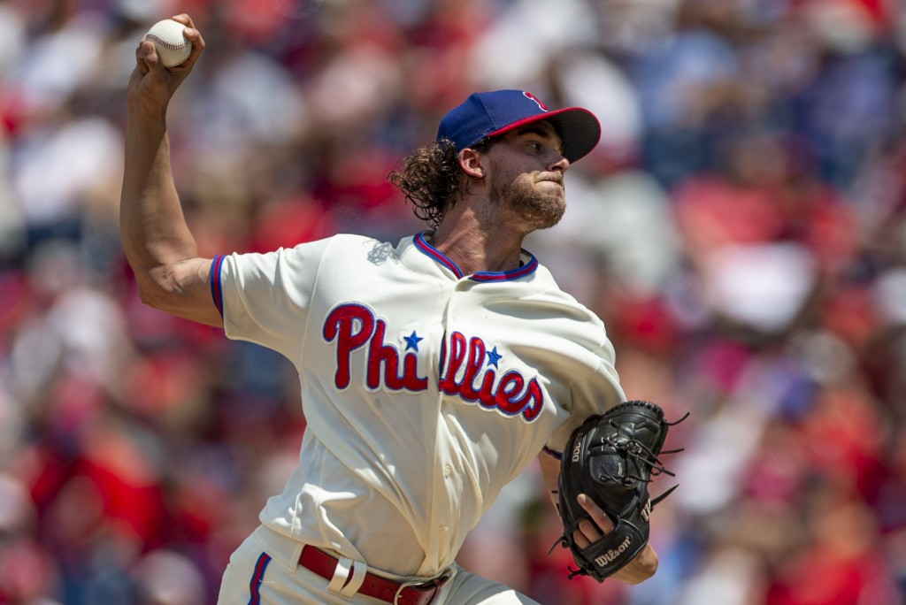 Philadelphia Phillies starting pitcher Aaron Nola throws during the first inning of a baseball game against the Miami Marlins, Sunday, Aug. 5, 2018, i...