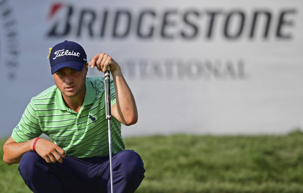 Justin Thomas reads the green on the 18th hole during the final round of the Bridgestone Invitational golf tournament at Firestone Country Club, Sunda