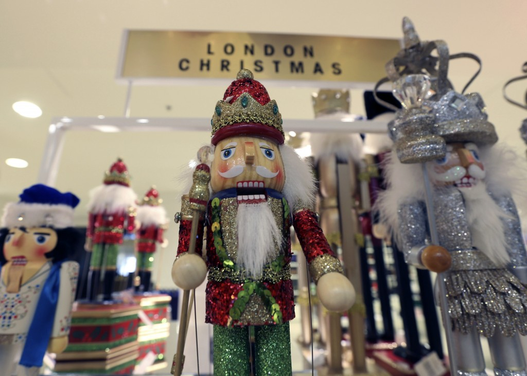 560b5ca4d8dfe A wooden figure features in a Christmas display in Selfridges in London