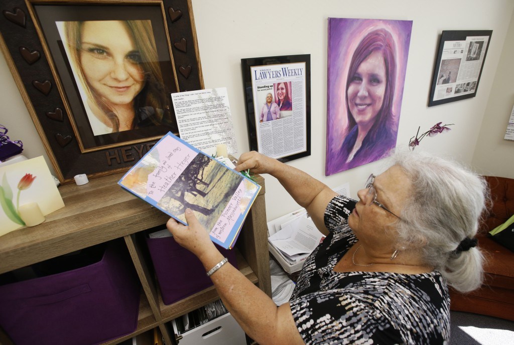 In this Monday, Aug. 6, 2018 photo, Susan Bro, mother of Heather Heyer, who was killed during the Unite the Right rally last year, looks over memorabi
