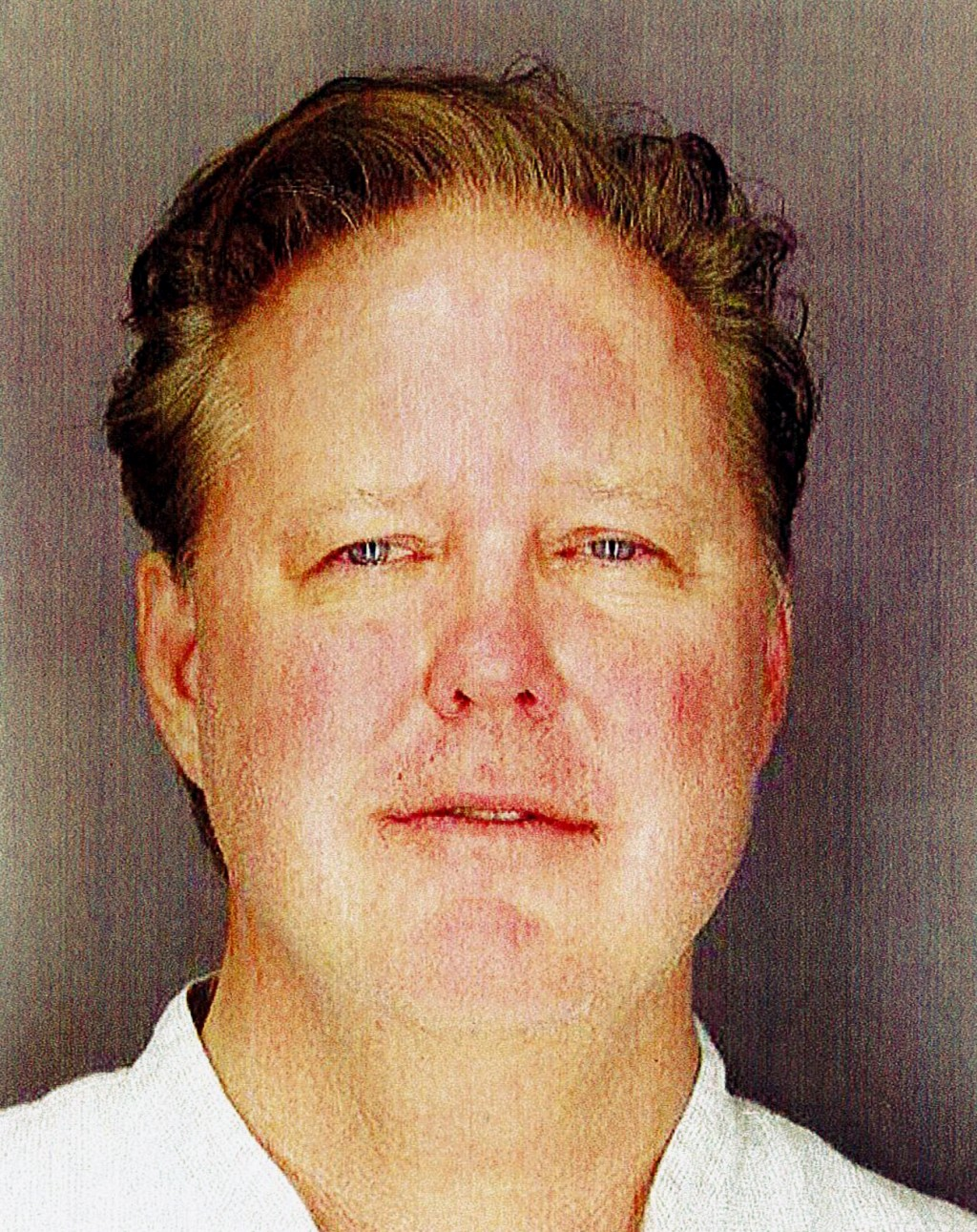 This undated photo provided by Sag Harbor Village Police Department on Monday Aug. 6, 2018, shows Brian France, chairman of NASCAR, taken after his ar