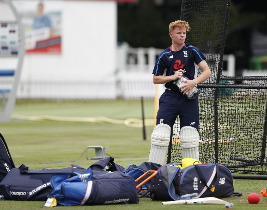 England's new cricket test match squad member Ollie Pope pads up during a training session at Lord's Cricket ground in London, Tuesday, Aug. 7, 2018.