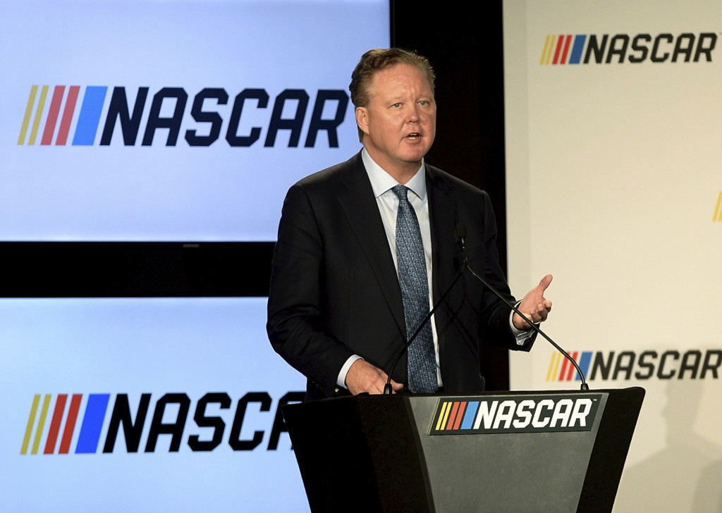 FILE - In this Jan. 23, 2017, file photo, Brian France, Chairman of NASCAR, gives opening remarks prior to an announcement of NASCAR's approach to mod...