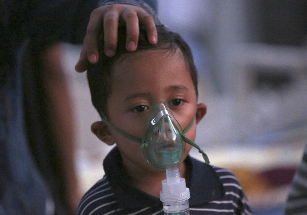 A child injured in the earthquake receives oxygen at a makeshift hospital in Tanjung, North Lombok, Indonesia, Tuesday, Aug. 7, 2018. The north of Lom...