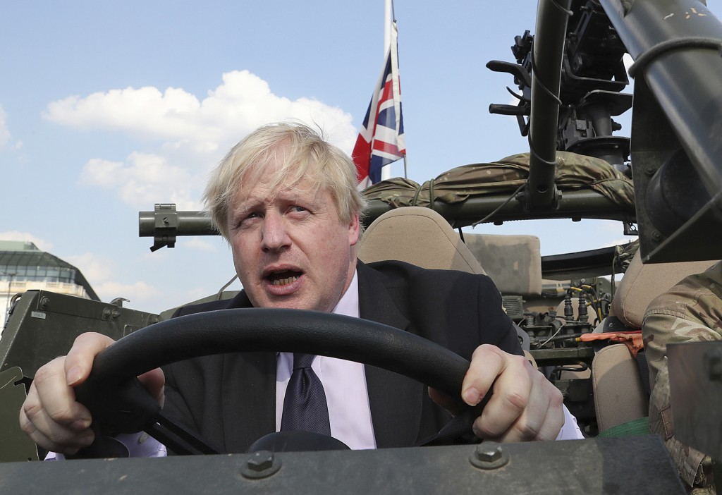 FILE - In this file photo dated Thursday, June 21, 2018, Britain's Foreign Secretary Boris Johnson talks during a ceremony at the Tomb of the Unknown