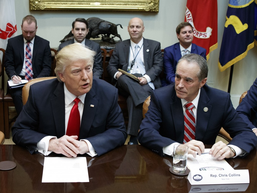 Chris Collins of western New York state right sits next to President Donald Trump duri