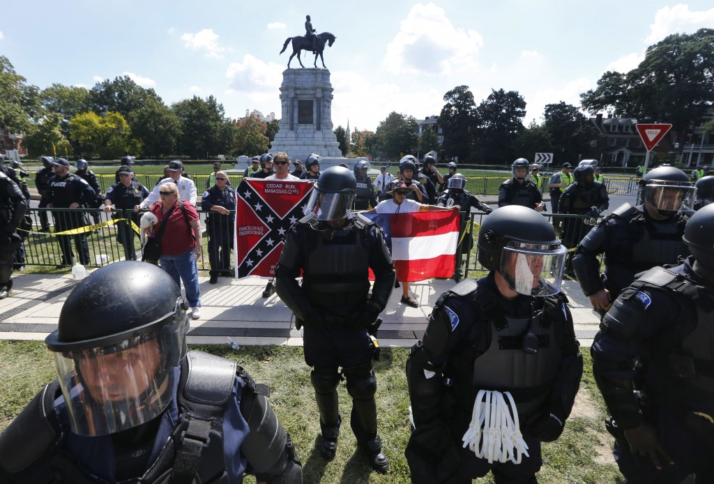 FILE - In this Sept. 16, 2017, file photo, State Police keep a handful of Confederate protesters separated from counter demonstrators in front of the