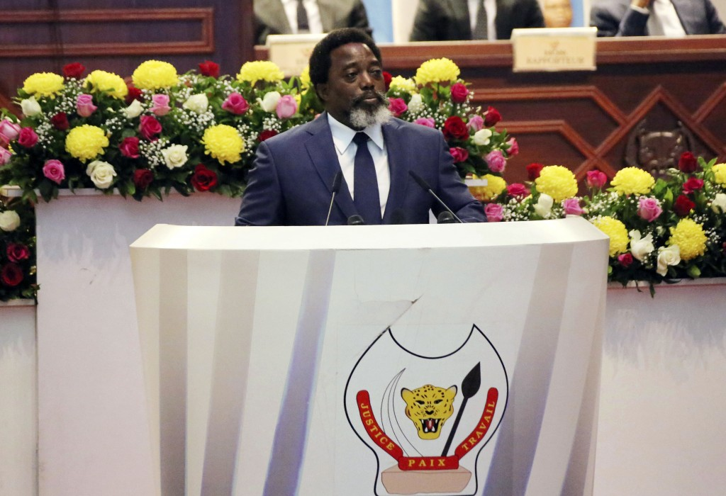 FILE - In this Thursday, July 19, 2018 file photo, Congo's President Joseph Kabila speaks during the state of the nation address to the National Assem...
