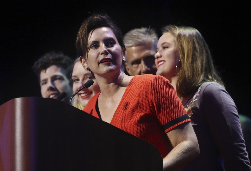 Michigan Democratic gubernatorial candidate Gretchen Whitmer stands with her family and addresses her supporters after winning the primary, Tuesday, A