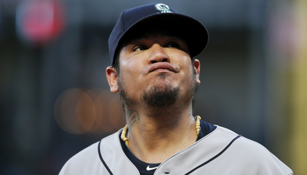 Seattle Mariners starting pitcher Felix Hernandez reacts after allowing a soft bunt-single by Texas Rangers' Carlos Tocci during the third inning of a
