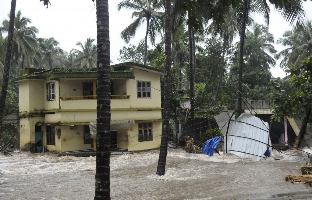 Roads and houses are engulfed in water following heavy rain and landslide in Kozhikode, Kerala state, India, Thursday, Aug. 9, 2018. Landslides trigge