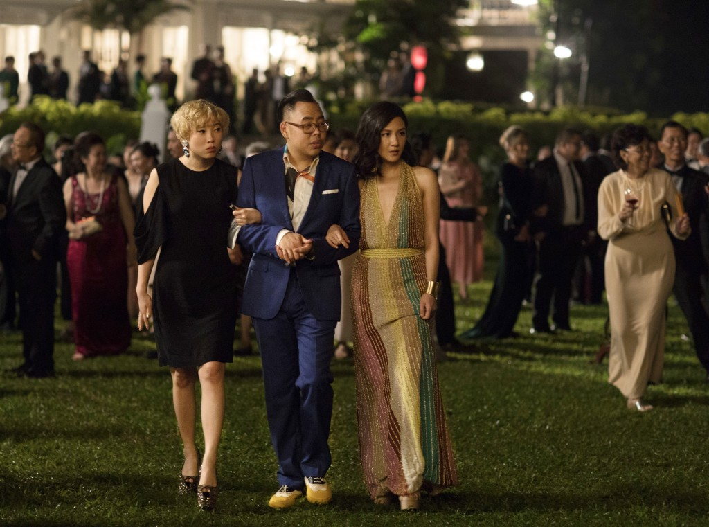 """This image released by Warner Bros. Entertainment shows Awkwafina, from left, Nico Santos and Constance Wu in a scene from the film """"Crazy Rich Asians..."""