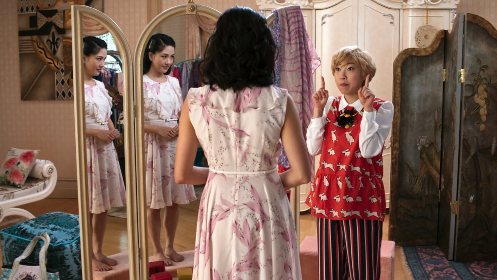 """This image released by Warner Bros. Entertainment shows Constance Wu, left, and Awkwafina in a scene from the film """"Crazy Rich Asians."""" (Warner Bros. ..."""