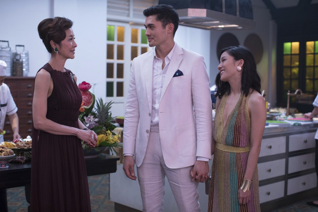 """This image released by Warner Bros. Entertainment shows Michelle Yeoh, from left, Henry Golding and Constance Wu in a scene from the film """"Crazy Rich ..."""