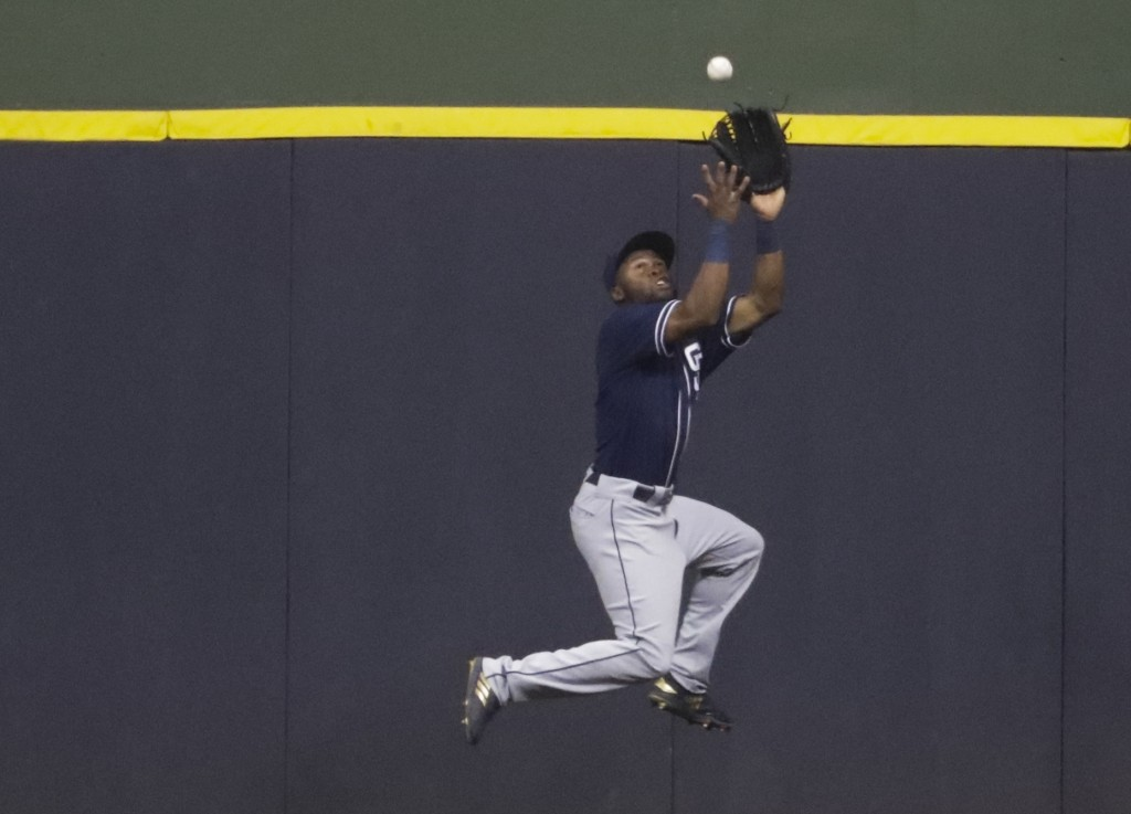 San Diego Padres' Manuel Margot makes a leaping catch of a ball hit by Milwaukee Brewers' Jesus Aguilar during the fourth inning of a baseball game We