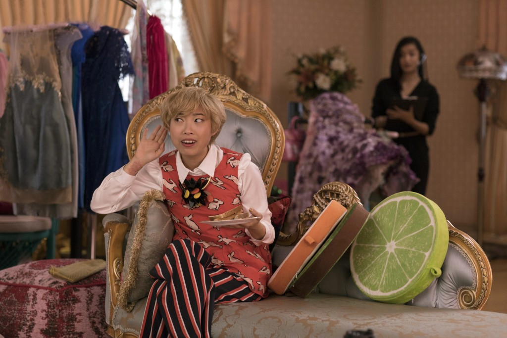 """This image released by Warner Bros. Entertainment shows Awkwafina in a scene from the film """"Crazy Rich Asians."""" (Sanja Bucko/Warner Bros. Entertainmen..."""