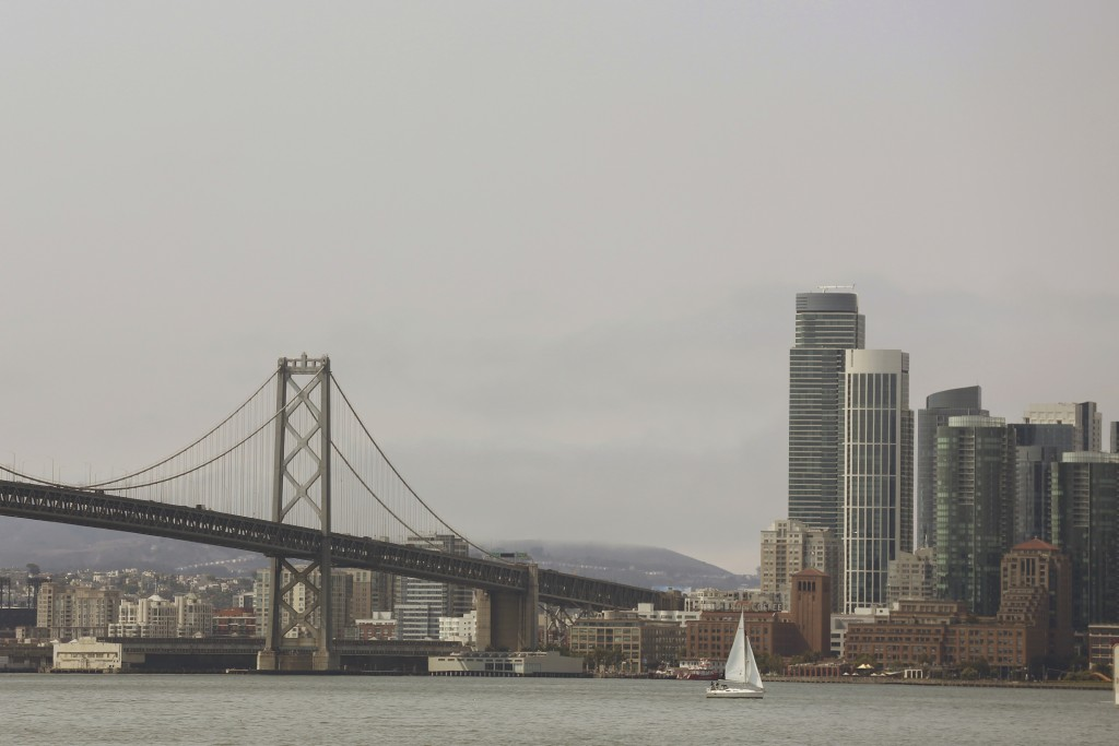 A haze of smoke blankets San Francisco Wednesday, Aug. 8, 2018. Public health and air quality experts say the smoke drifting over cities in California