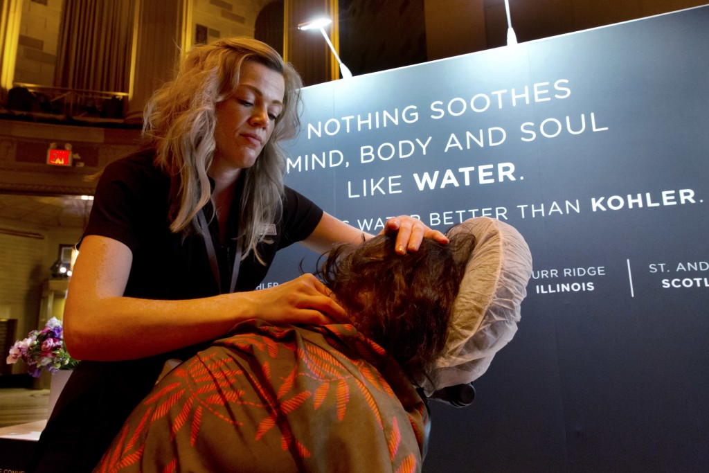 Kelly Hawe, left, Spa Lead-Esthetics at the Kohler Waters Spa, in Kohler, Wisc., applies a massage at the annual International Spa Association event, ...