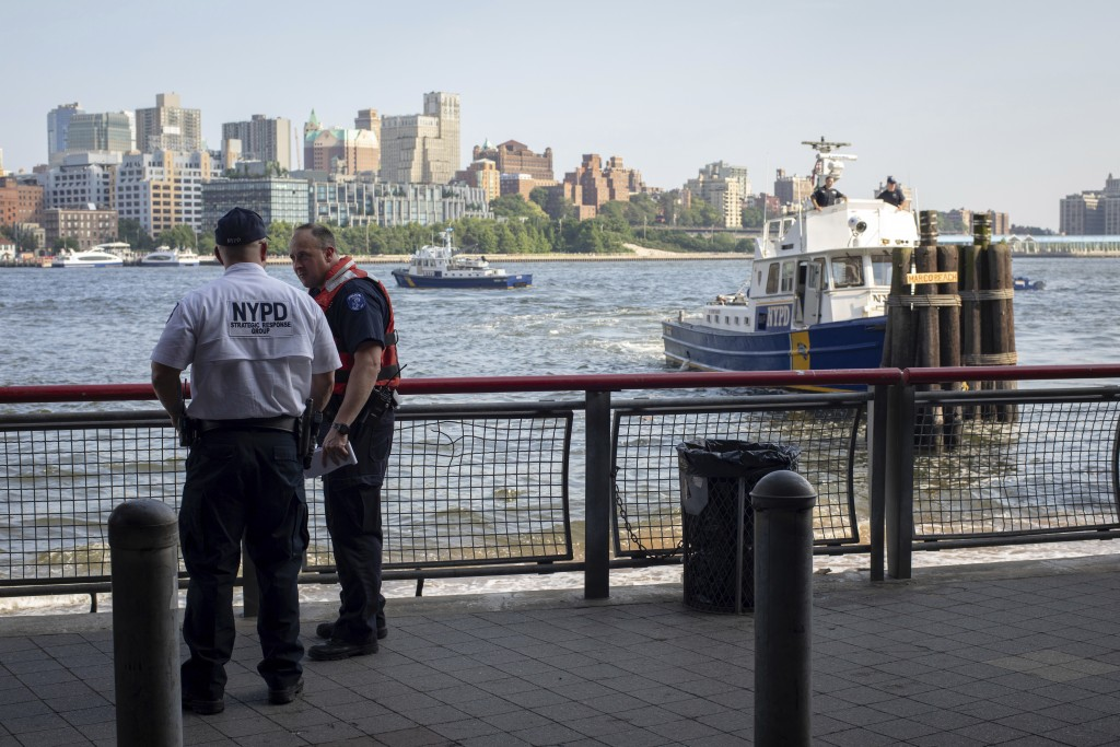 FILE - In this Aug. 5, 2018, file photo, authorities investigate the death of a baby boy who was found floating in the East River near the Brooklyn Br