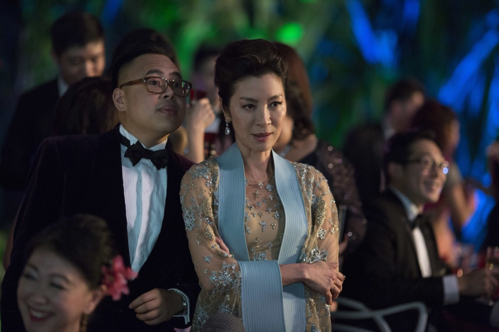 """This image released by Warner Bros. Entertainment shows Nico Santos, left, and Michelle Yeoh in a scene from the film """"Crazy Rich Asians."""" (Sanja Buck..."""