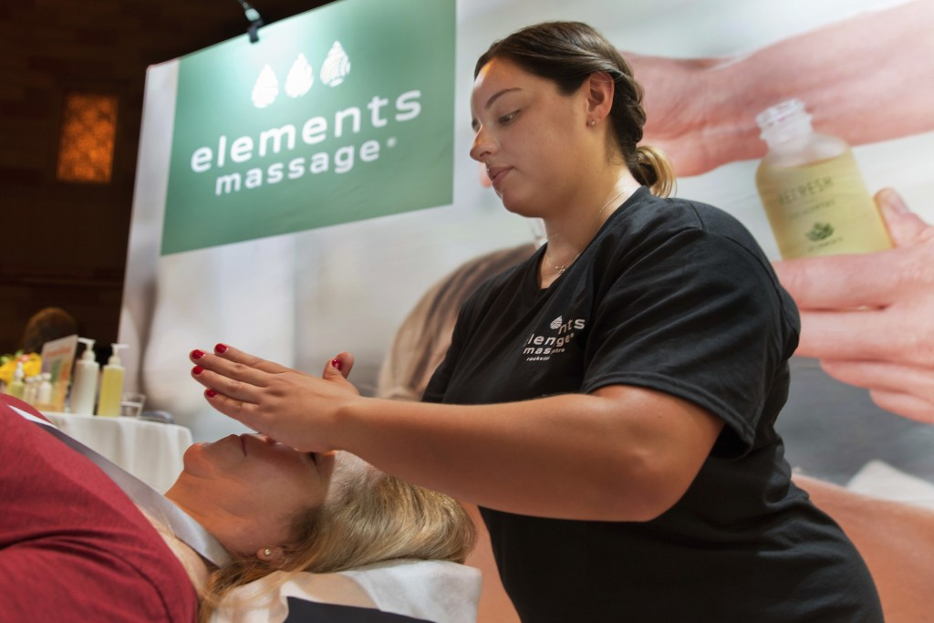 Adrianna DeJesus, right, of Elements Massage in Englewood, Colo., demonstrates their AromaRitual experience at the annual International Spa Associatio...