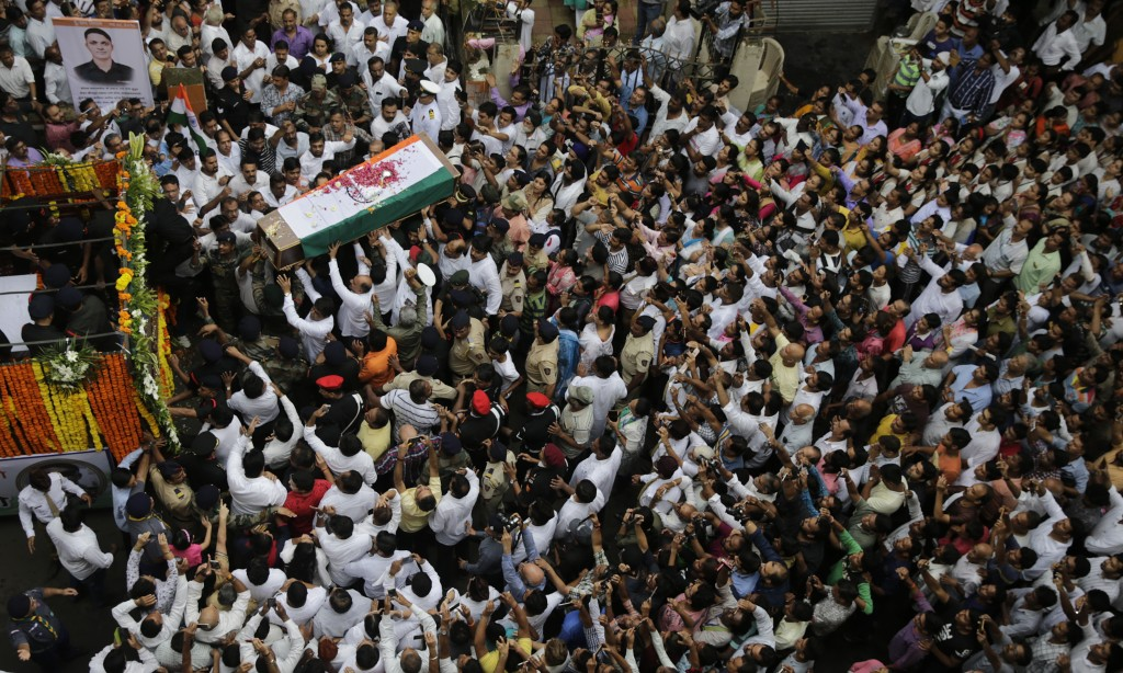 In this Thursday, Aug 9, 2018, file photo, people carry the coffin of Indian Army Major Kaustubh Rane, who was killed in a gun battle Tuesday in Kashm
