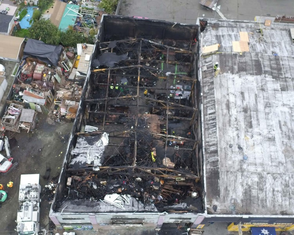 FILE - This undated file photo provided by the City of Oakland shows inside the burned warehouse after the deadly fire that broke out on Dec. 2, 2016,...
