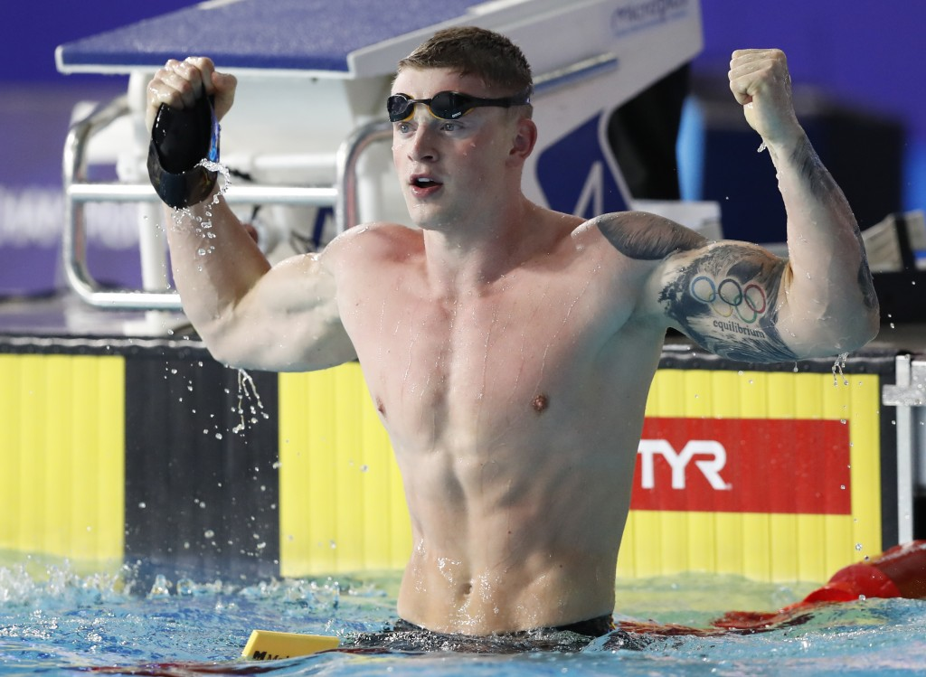 Adam Peaty of Great Britain celebrates after winning the gold medal in the 50 meter breaststroke men final at the European Swimming Championships in G...
