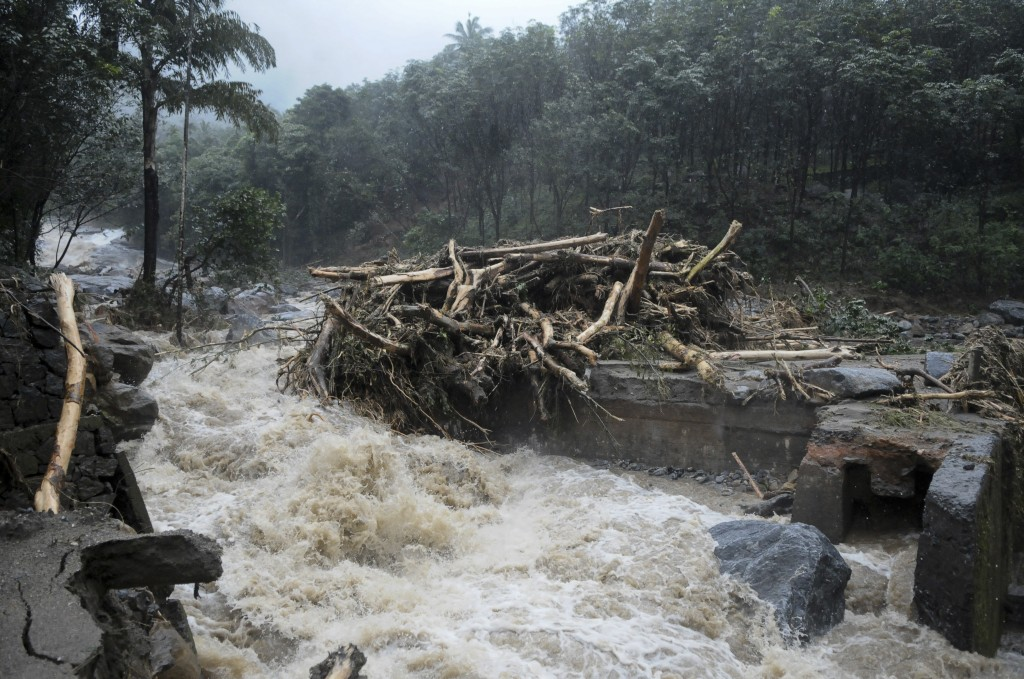 Water gushes out following heavy rain and landslide in Kozhikode, Kerala state, India, Thursday, Aug. 9, 2018. Landslides triggered by heavy monsoon r