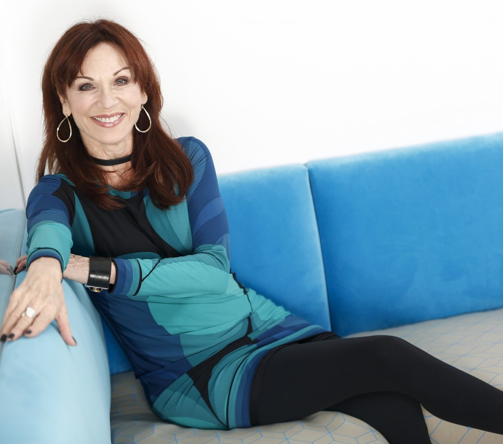 """In this July 26, 2018 photo, actress Marilu Henner poses for a portrait in New York to promote her seventh Broadway show, """"Gettin' The Band Back Toget"""