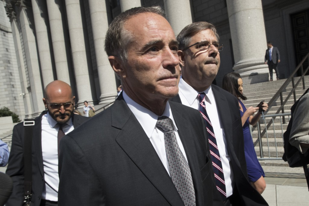 Republican U.S. Rep. Christopher Collins, center, leaves federal court, Wednesday, Aug. 8, 2018, in New York. Rep. Collins of western New York state h