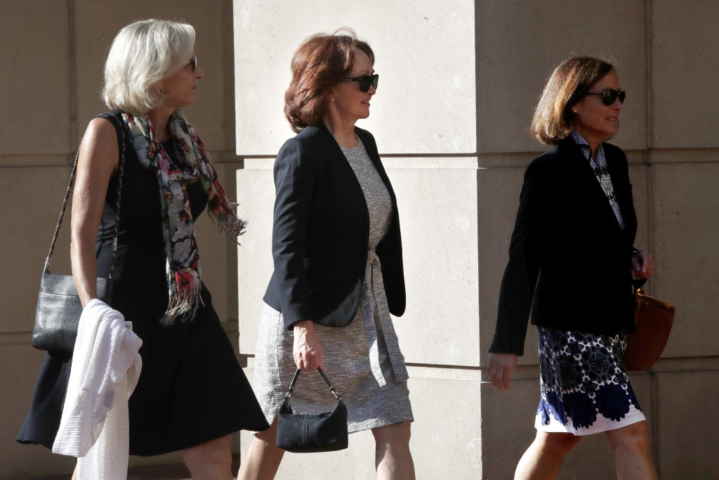 Kathleen Manafort, center, wife of former Trump campaign chairman Paul Manafort, arrives at federal court as Paul Manafort's trial continues, in Alexa
