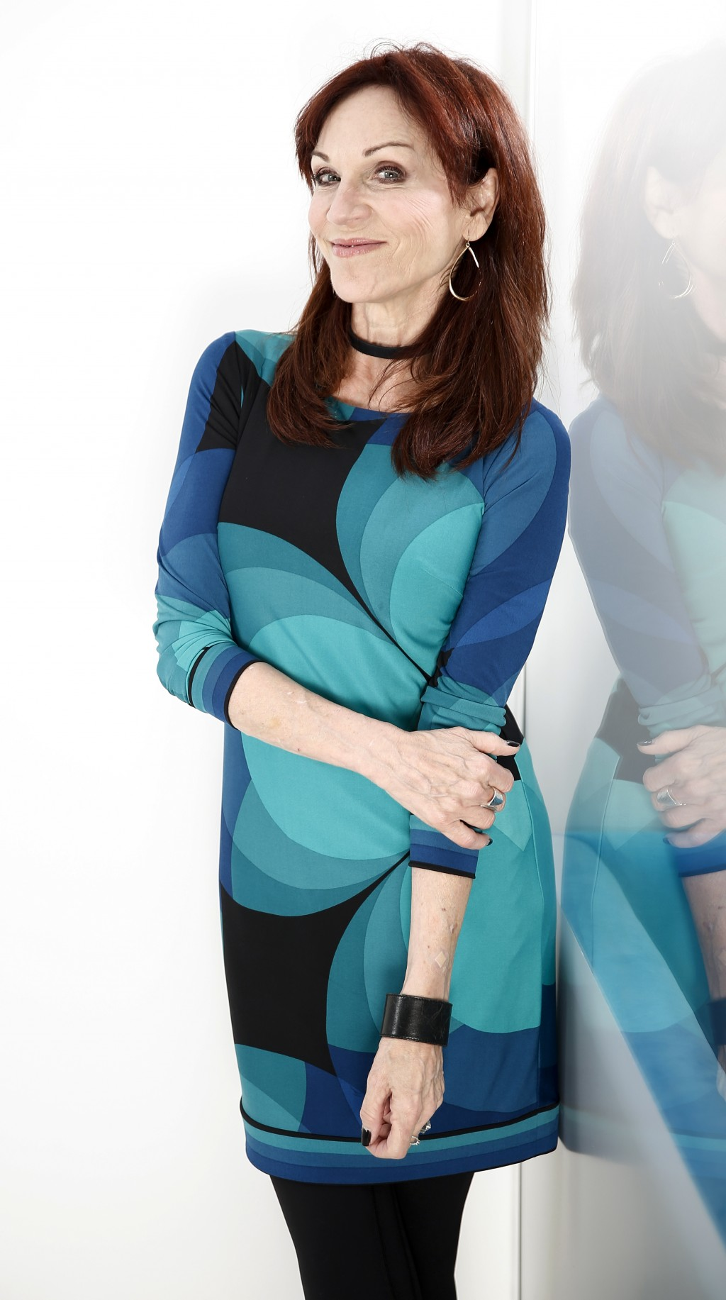 "In this July 26, 2018 photo, actress Marilu Henner poses for a portrait in New York to promote her seventh Broadway show, ""Gettin' The Band Back Toget"