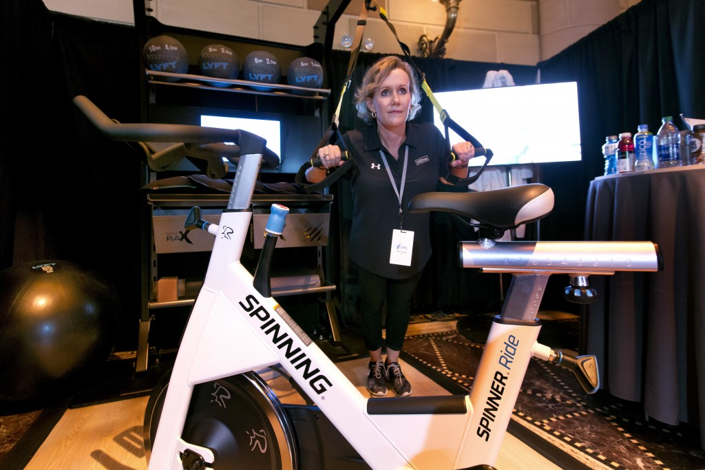 Melissa Walker, Senior Director Global Wellness from Hilton, in McLean, Va., demonstrates their in-room Fitness Solution, at the annual International ...
