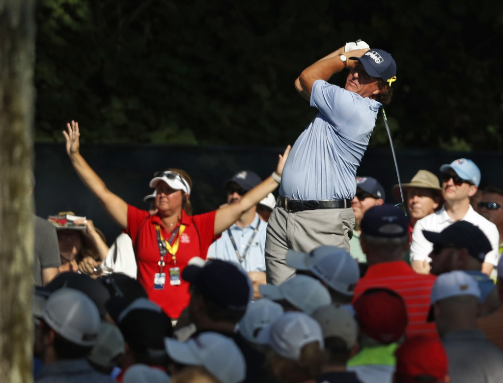 Phil Mickelson tees off on the 15th hole during the first round of the PGA Championship golf tournament at Bellerive Country Club, Thursday, Aug. 9, 2