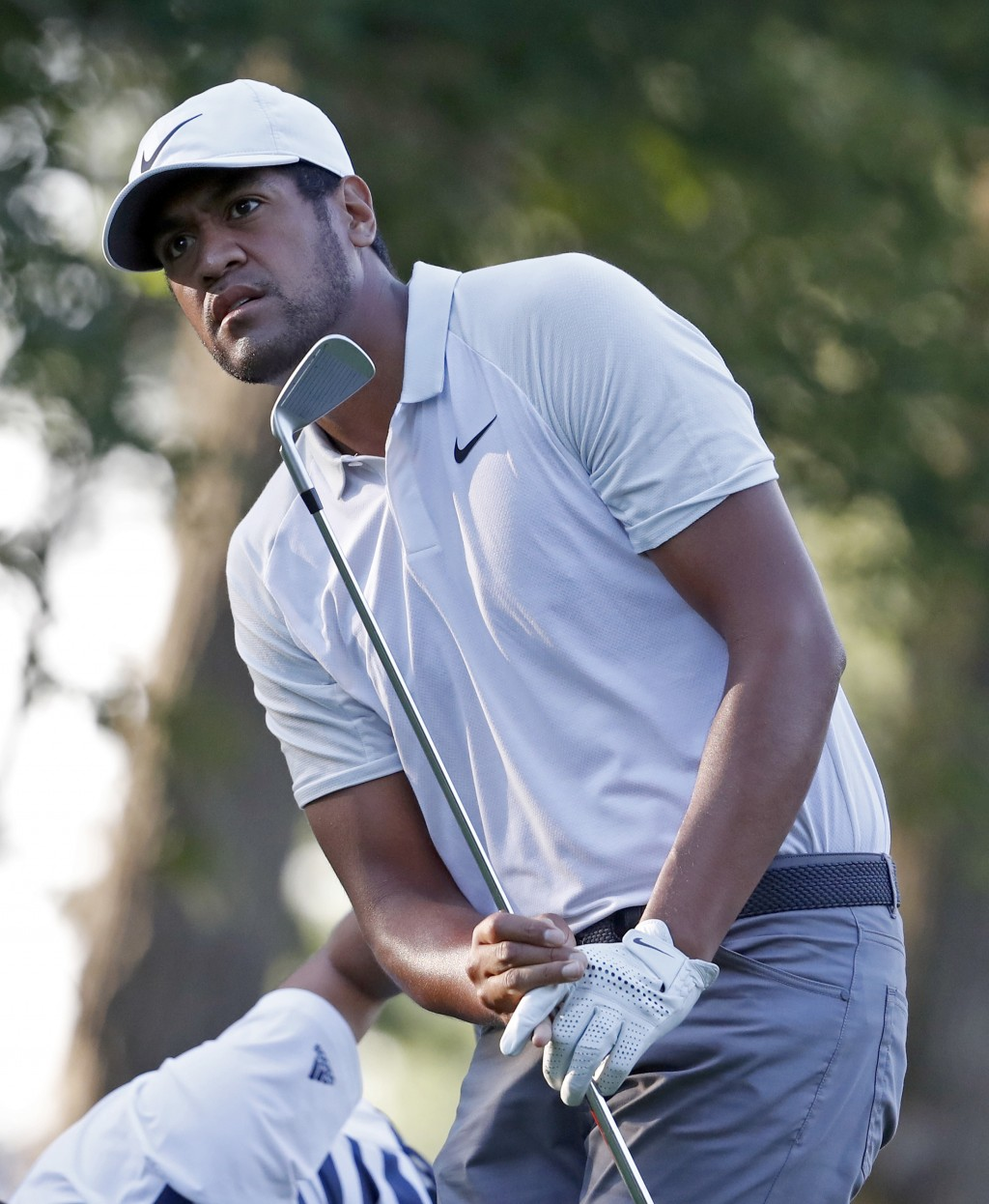 Tony Finau watches his tee shot on the 11th hole during the first round of the PGA Championship golf tournament at Bellerive Country Club, Thursday, A