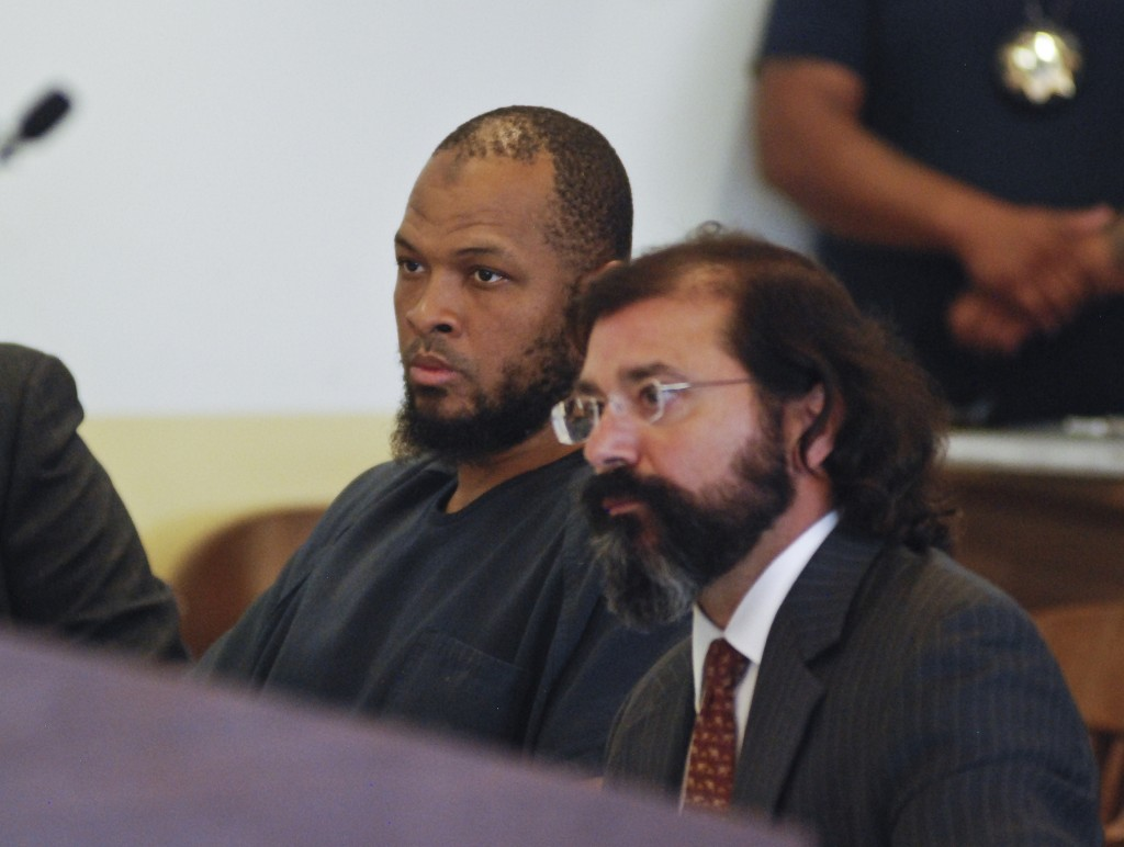Siraj Ibn Wahhaj, left, sits next to public defense attorney Aleks Kostich at a first appearance in New Mexico state district court in Taos, N.M., Wed