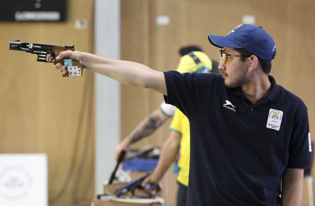 In this April 13, 2018, file photo, Anish Bhanwala of India shoots during the men's 25m Rapid Fire Pistol final at the Belmont Shooting Centre during