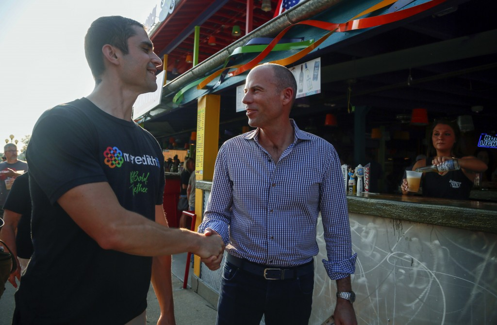 Michael Avenatti, the lawyer representing adult film actress Stormy Daniels, shakes hands at the Iowa State Fair in Des Moines, Iowa, Thursday, Aug. 9