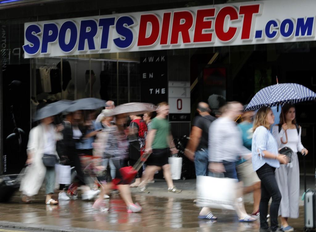 Pedestrians walk past British retailer Sports Direct store at Oxford Street in London, Friday, Aug. 10, 2018. British retailer Sports Direct said Frid