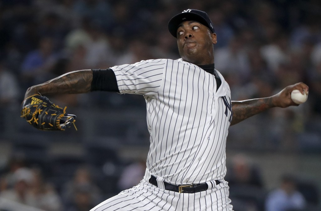 New York Yankees relief pitcher Aroldis Chapman delivers against the Texas Rangers during the ninth inning of a baseball game, Thursday, Aug. 9, 2018,