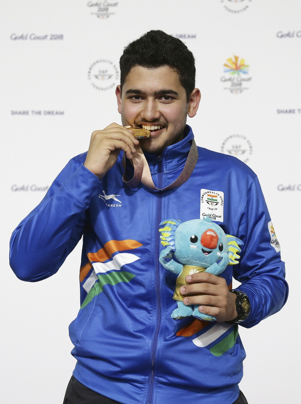 In this April 13, 2018, file photo, Anish Bhanwala of India celebrates with his gold medal at the men's 25m Rapid Fire Pistol final at the Belmont Sho