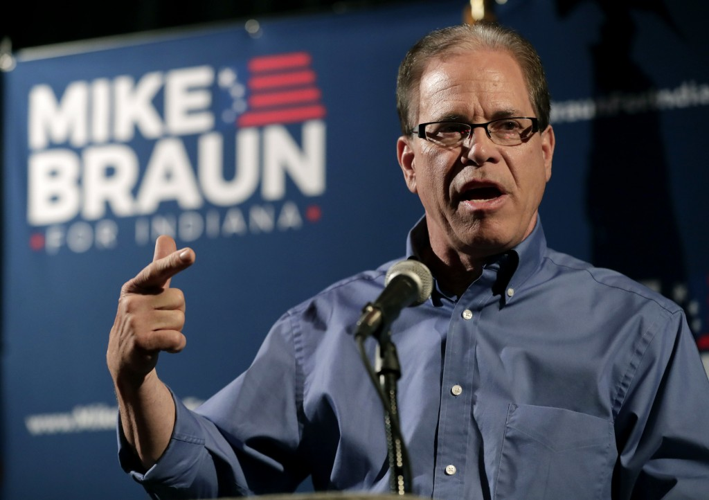 FILE - This May 8, 2018 file photo Republican Senate candidate Mike Braun thanks supporters after winning the republican primary in Whitestown, Ind. B